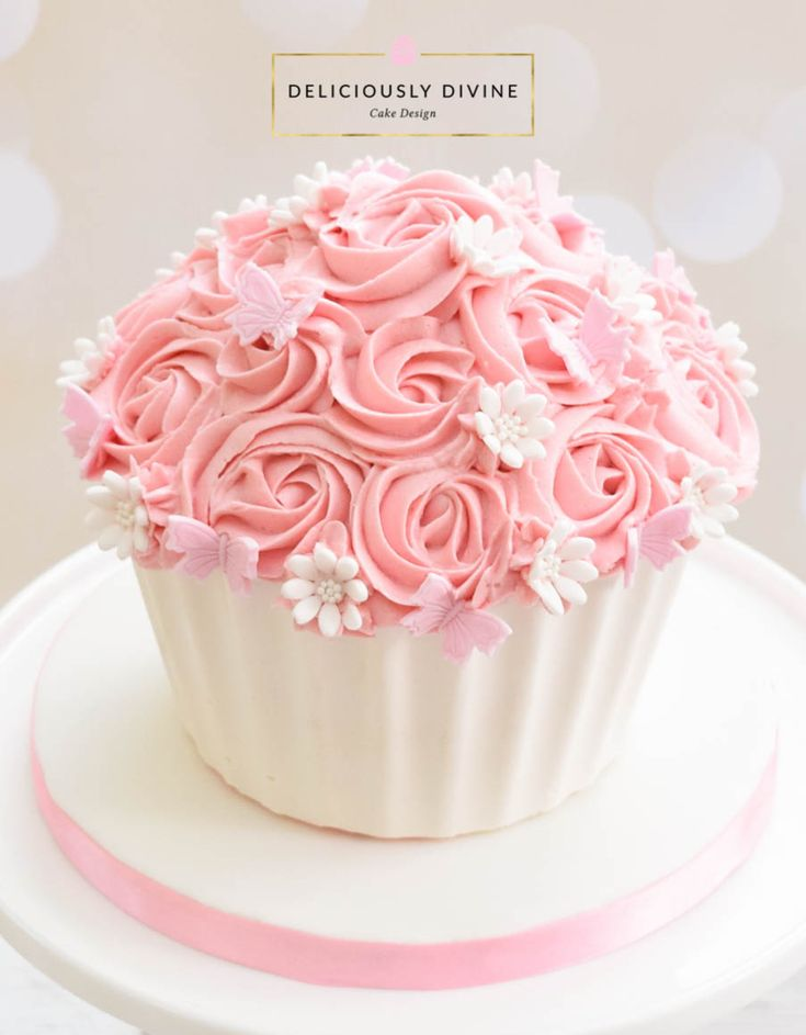 A cake smash giant cupcake for a girls 1st birthday. Sweet, pretty and pink topping of buttercream roses with a white chocolate candy melt shell. Great for any girl or ladies birthday celebration. An ideal cake for any girls, birthday, be it mum, grandma, auntie, sister or daughter, young or old and would make a fabulous wedding cake. To enquire or book email: lee-anne@deliciouslydivine.co.uk