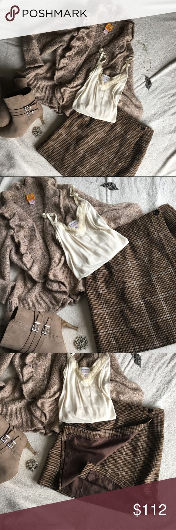 NWOT| J. Crew Houndstooth Wool Wrap Skirt NWOT| J. Crew Fully Lined Wool Wrap Skirt |This on-trend Wrap Skirt has J. Crew's classic sense of style in every thread. Dark mocha and creamy almond coloured Houndstooth mens-y pattern is counterbalanced with a chic and flirty above-the-knee hem. Pairs perfectly with your favourite pair of ankle boots or flats. To add an extra little touch of feminine charm, pair with a ruffled accent piece such as the Ruby Rd. Open Front Cardigan shown. It's also…