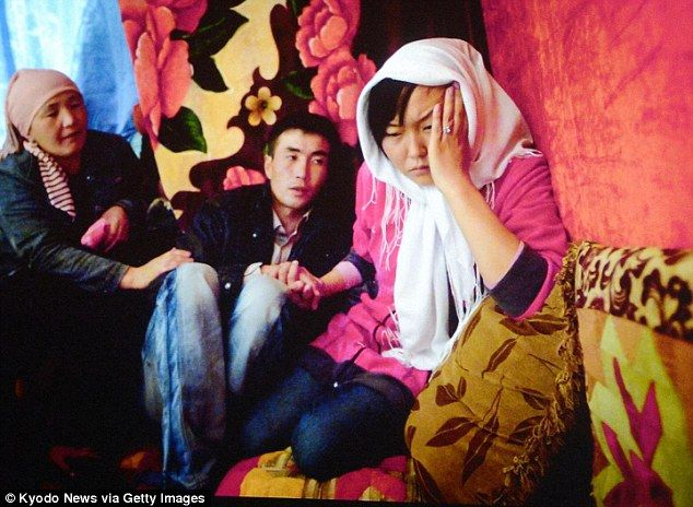 Troubling trend: A young Kyrgyzstani woman has revealed how bride kidnapping is still a common problem in the central Asian country despite being made illegal 13 years ago (above, an image captured by Noriko Hayashi showing a bride kidnapping in Kyrgyzstan)