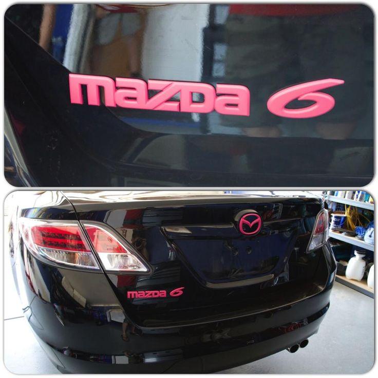 Mazda 6 black with pink emblems