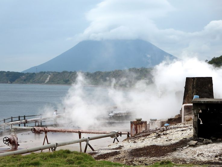 The Fuji-like cone of Kaimondake Volcano rises behind the steaming Yamagawa salt works near Yamagawa at the south end of Kyushu Island, Japan.