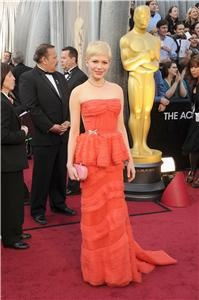 Poll: Love or hate Michelle Williams' coral Louis Vuitton gown?    Vote now: http://liveblogs.globalnews.ca/Event/Awards_Night