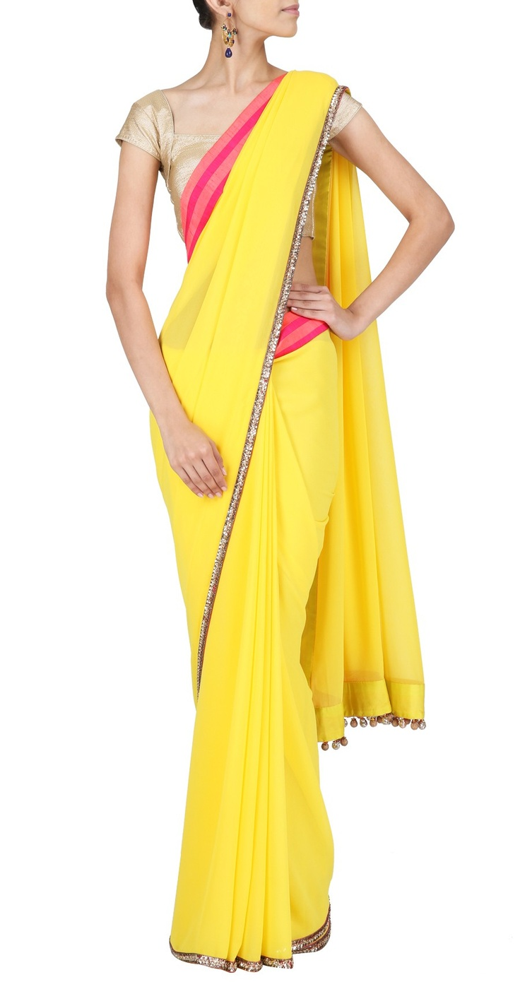 Yellow georgette Sari with neon pink and coral striped border and golu's. It comes with a neon pink and yellow raw silk blouse piece and a yellow satin petticoat piece.