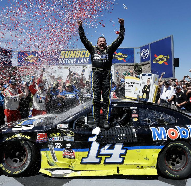 Tony Stewart returned to victory lane for the first time in three years in vintage fashion — refusing to let Denny Hamlin steal a win at Sonoma Raceway away from him on the final lap Sunday. The 45-year-old took the lead on fuel strategy during a caution with 24 laps to go, and had to hold on after another yellow flag stalled the race. The final restart came with 14 laps remaining — the same number as Stewart's car — and he held off a trio of Toyota drivers for his third career victory at…