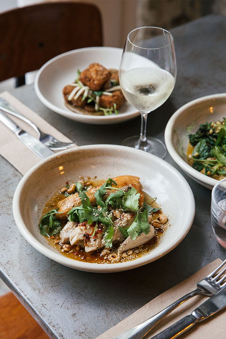 This chicken blows our mind. Cooked long and slow in white wine, it's served with house-made Tunisian-style harissa, fresh coriander and pops of toasty hazelnuts.
