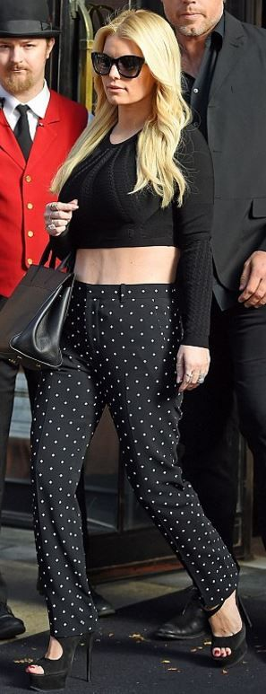 Who made  Jessica Simpson's cat sunglasses, tote handbag, dot pants, and platform suede sandals?