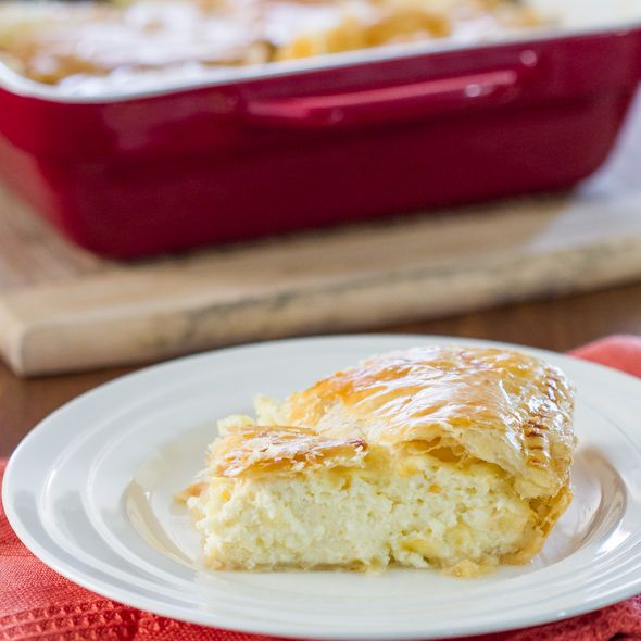 Greek Savory Cheese Pie - Greek Savory Cheese Pie - a traditional and very popular European treat. A cheese pie filling made with bechamel sauce, feta cheese, ricotta between 2 layers of puff pastry.