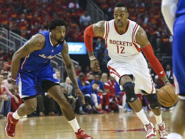 Game 7 in Houston: Rockets vs. Clippers — Houston center Dwight Howard (12) tries to drive the lane against Los Angeles defender DeAndre Jordan (6).  Troy Taormina, USA TODAY Sports