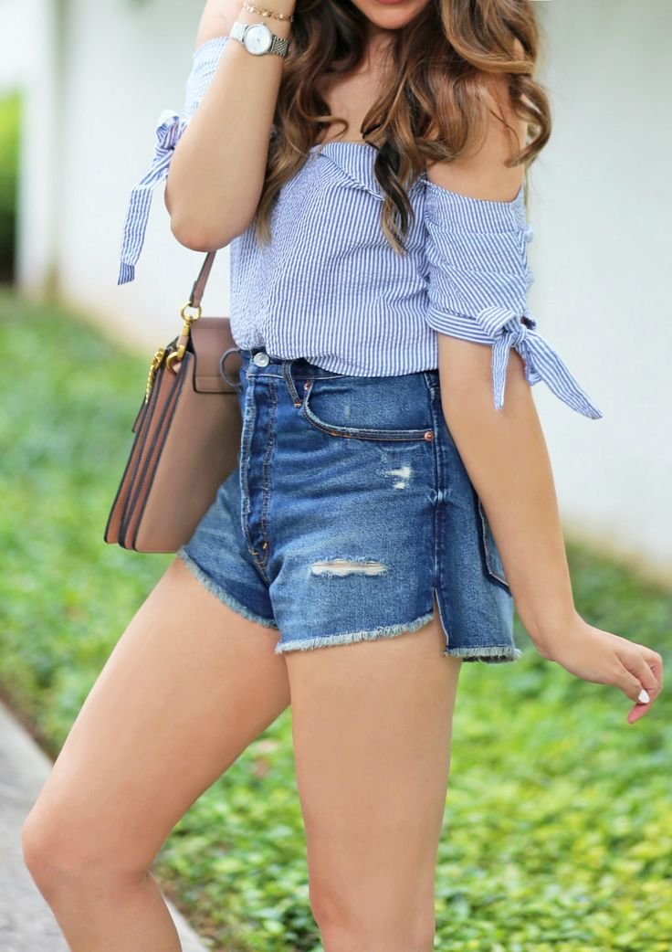 Someone buy me this top. | Fashion blogger Mash Elle styles a blue striped seersucker off the shoulder top from Urban Outfitters  with high waisted cut off ripped jeans short from Abercrombie and Fitch shorts, Michael Hill watch, and Chloe Faye purse.
