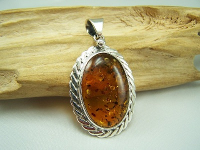 Unique Baltic amber medalion,pendant with cognac stone.