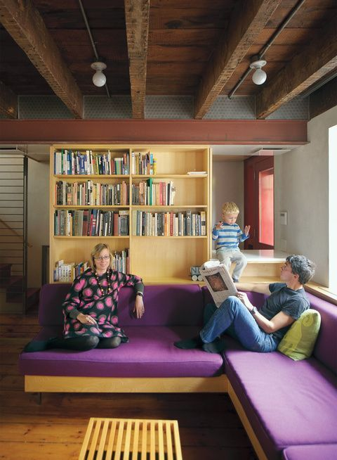 Modern living room renovation with purple cushion sofa and exposed ceiling beams
