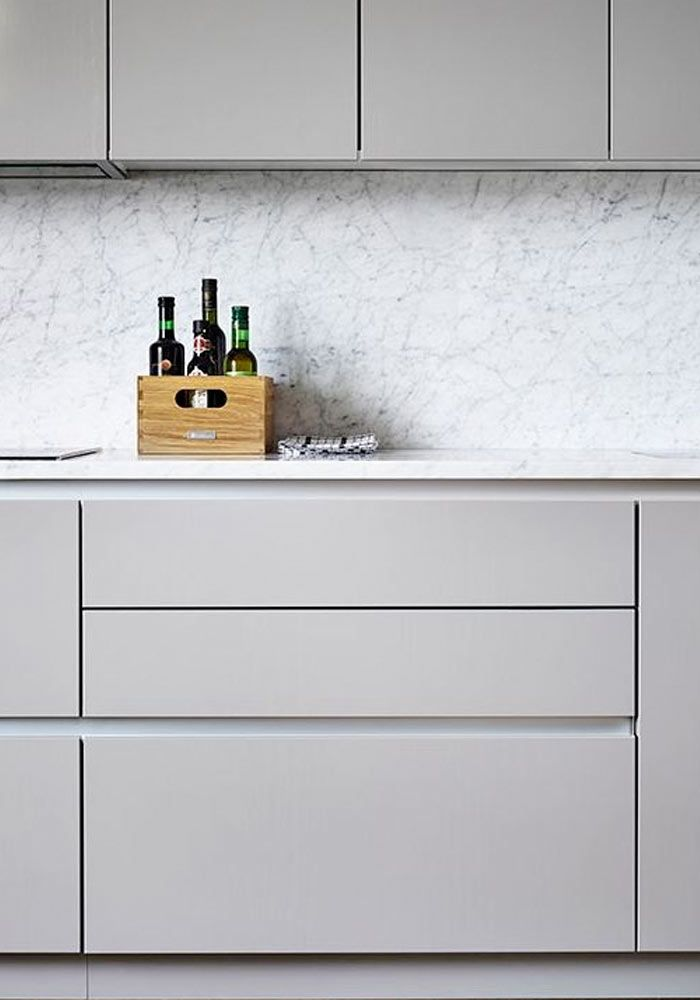 minimalist grey kitchen with marble worktop