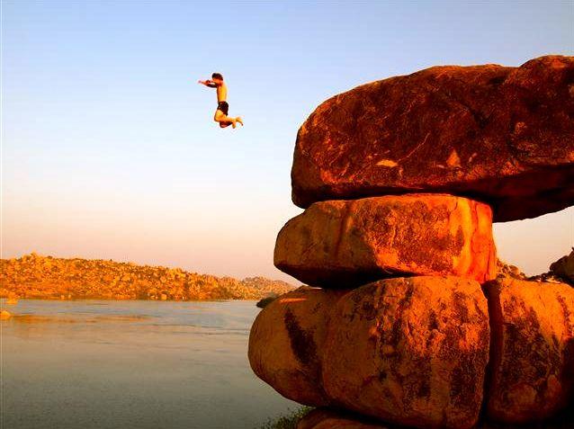 Diving off boulders in Hampi, India