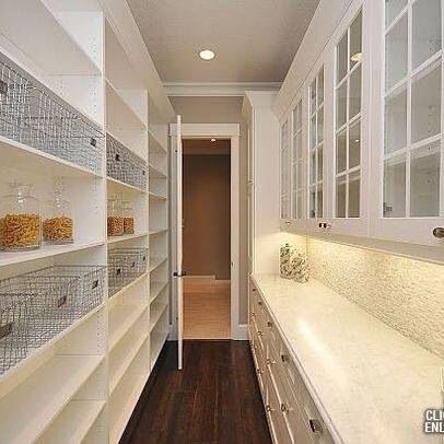 Large pantry - narrow space, wire baskets, counter top& cabinets with doors