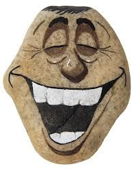 Laughing face painted on a rock