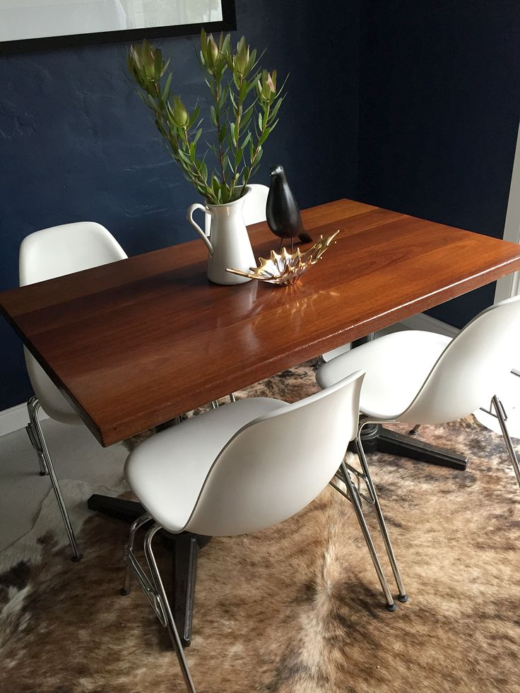 Eames DSS side chairs by Vitra with vintage Thonet table