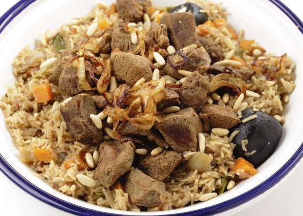 SAUDI ARABIA:  Kabsa - A mixture of rice, meat, vegetables and spices, garnished with almonds and pine nuts, a Biryani-like specialty of the Gulf.