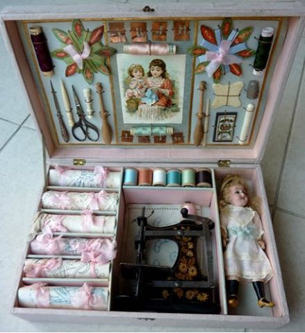 Sewing machine, thread, notions, doll and all! A vintage little girl's delight!