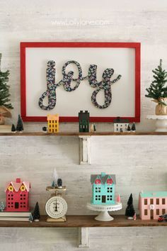 "DIY wood cutout sign tutorial. Learn how to cover a wood cutout with paper the proper way then mount to a sign! Such an easy to follow sign tutorial. Love this DIY ""joy"" sign."