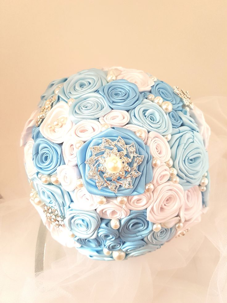 """Blue Bridal Brooch Bouquet, Blue Wedding Bouquet. White and 2 shades of blue handmade satin ribbon roses.  Silver tone brooches and pearl accents. 8"""" bouquet."""