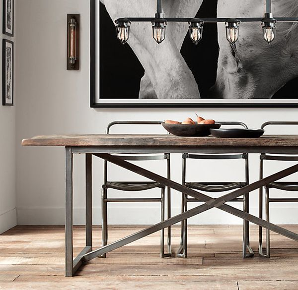 B L O O D A N D C H A M P A G N E . C O M: industrial lighting, wood table with metal frame.