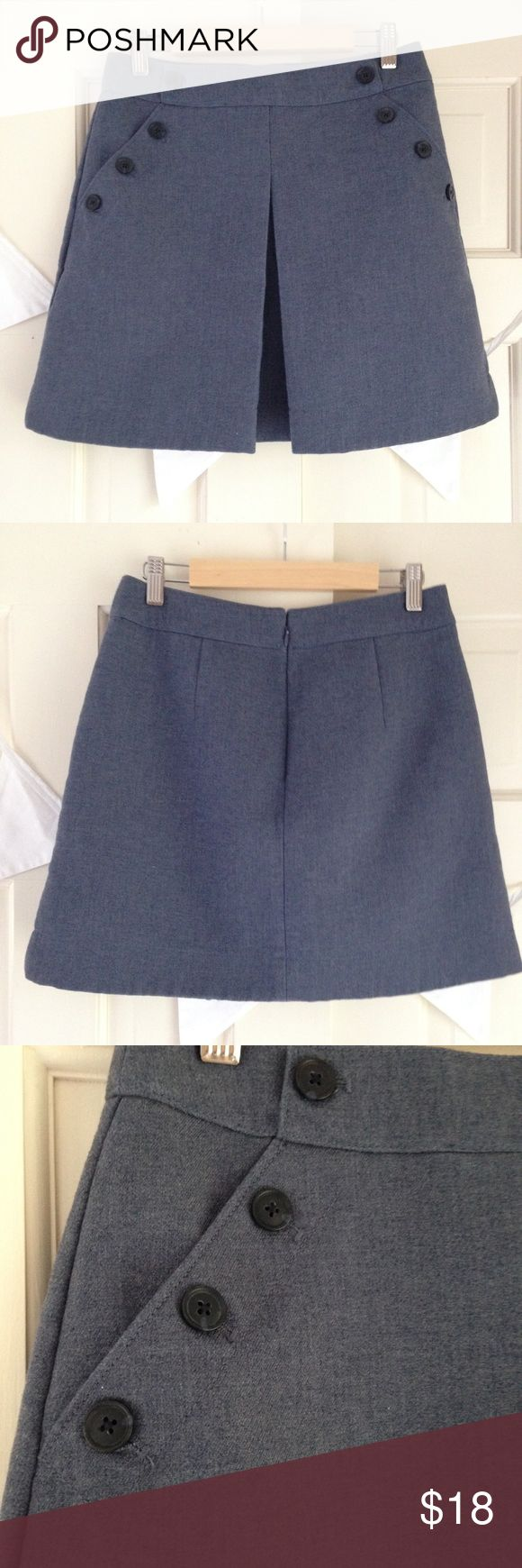 "GAP Sailor Mini Skirt Navy Melange Button Detail Cute GAP Sailor Mini in excellent preloved condition. This nautical skirt is heavier like wool (but a poly cotton blend) and is a lovely chambray looking color. Measurements laying flat approximately 14"" waist, 16"" length. GAP Skirts Mini"