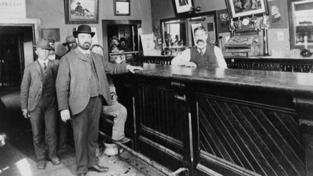 The bar at the Palace Hotel in Calgary in 1903, with owner Carl Wieting behind the bar. The hotel was located at 104, 9th Avenue West.
