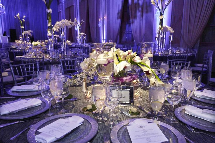 Sophisticated Tablescape    Photography: KingenSmith   Read More:  http://www.insideweddings.com/weddings/stunning-chicago-wedding-with-purple-lighting-ivory-florals/465/