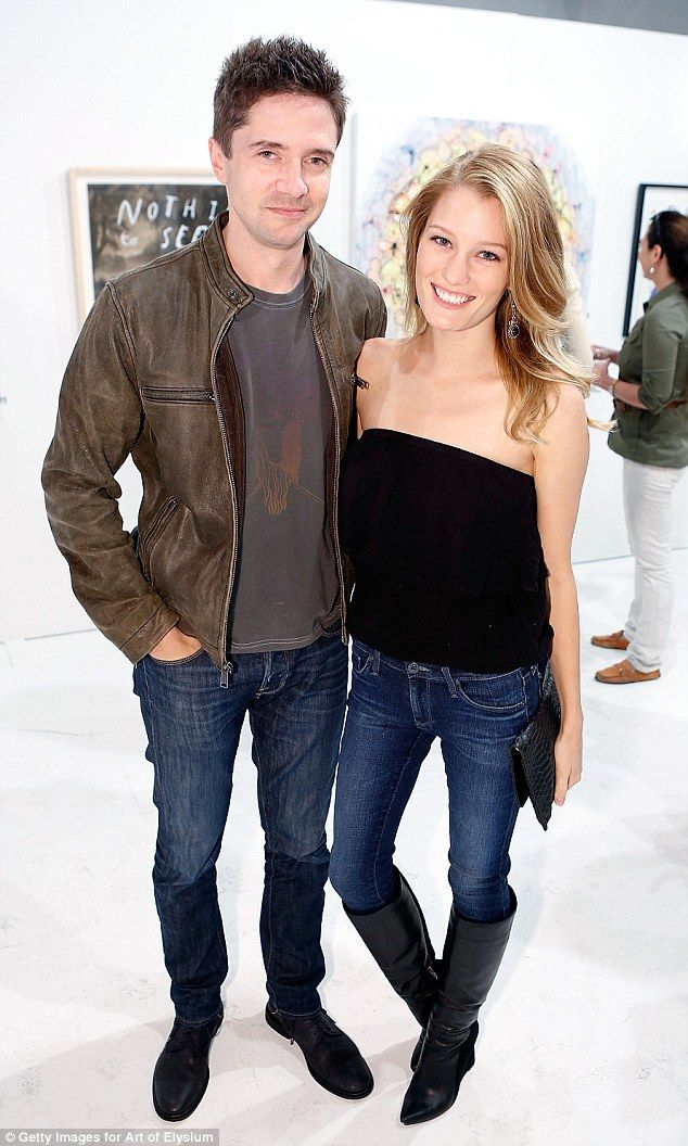 Happy couple: Topher and Ashley were all smiles at a Hollywood event last month