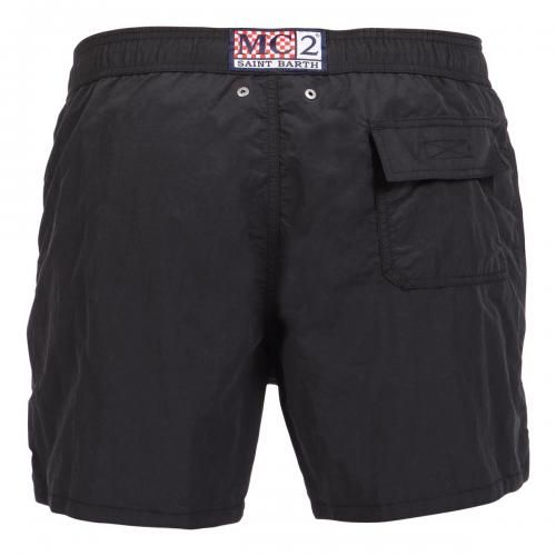 "BLACK NYLON SWIM SHORTS WITH SKULL PATTERN Black Nylon Long Swim Shorts featuring a skull and ""PIRATES DE SAINT BARTH"" writing at lateral side. Two front pockets and back Velcro pocket. Internal net. Elastic waistband with adjustable drawstring. COMPOSITION: 100% NYLON. Model wears size M, he is 189 cm tall and weighs 86 Kg."