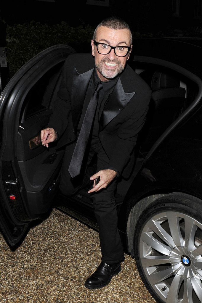 George Michael in good spirits arriving home after Elton John and David Furnish's White Tie and Tiara party in Windsor.