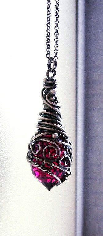 https://www.bkgjewelry.com/sapphire-ring/440-18k-yellow-gold-diamond-blue-sapphire-heart-ring.html Wire wrapped pendant
