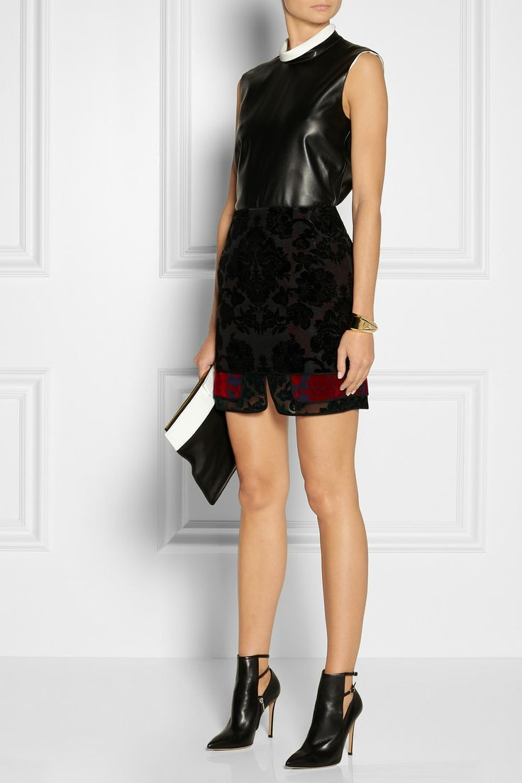 Calvin Klein Collection top, Togaskirt, Gianvito Rossi boots, NewbarK clutch, and Chloé cuff.