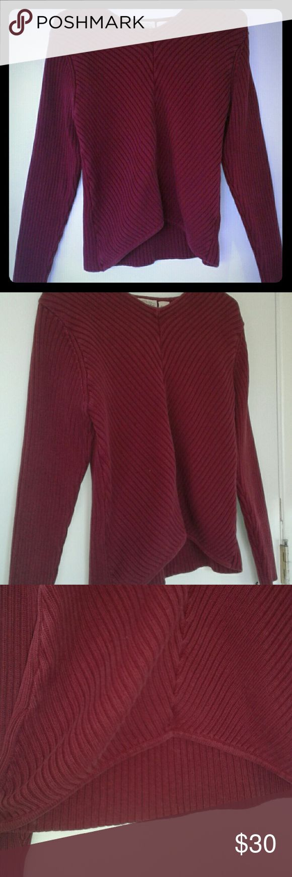 Maroon Sweater This is a thick and durable knit style sweater. Its nice as a layer, or on its own. There are some loose parts (pict 6) but it still holds up very well. The front is a little higher for added style. St. John's Bay Sweaters