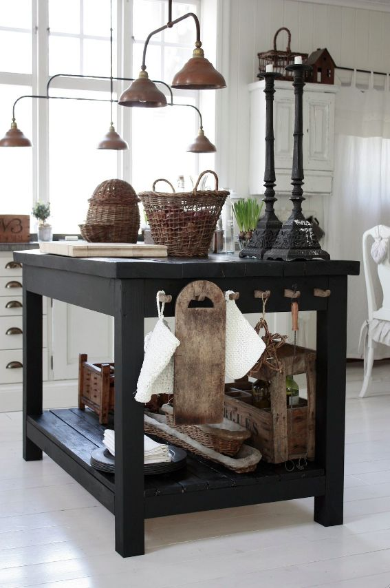 Industrial table used as kitchen island...love the industrial lights and everything on this table!