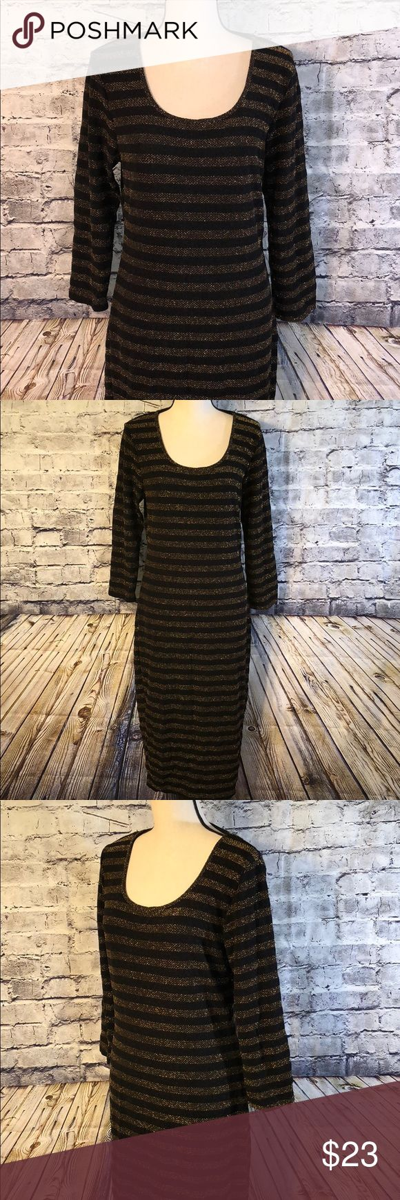 "Symphony Plus maxi dress Super stretchy black and shiny gold stripped maxi dress from Symphony Plus. This dress is stunning to see. The gold shimmers and shines which is hard to capture in pics. This dress is perfect for a girls night out or an evening of dancing 💃!   Approx measurements: Length-46"" Bust- 40"" unstretched.   Thanks for stopping by! Be sure to save $$ by bundling your likes!!  Happy Poshing! 🛒🎁🛍 Symphony Plus Dresses Maxi"