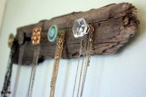Screw cheap furniture knobs into salvaged wood for a necklace holder