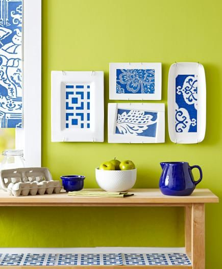 An interesting idea for kitchen wall art, though I probably wouldn't want to put it elsewhere. Platters and wallpaper.