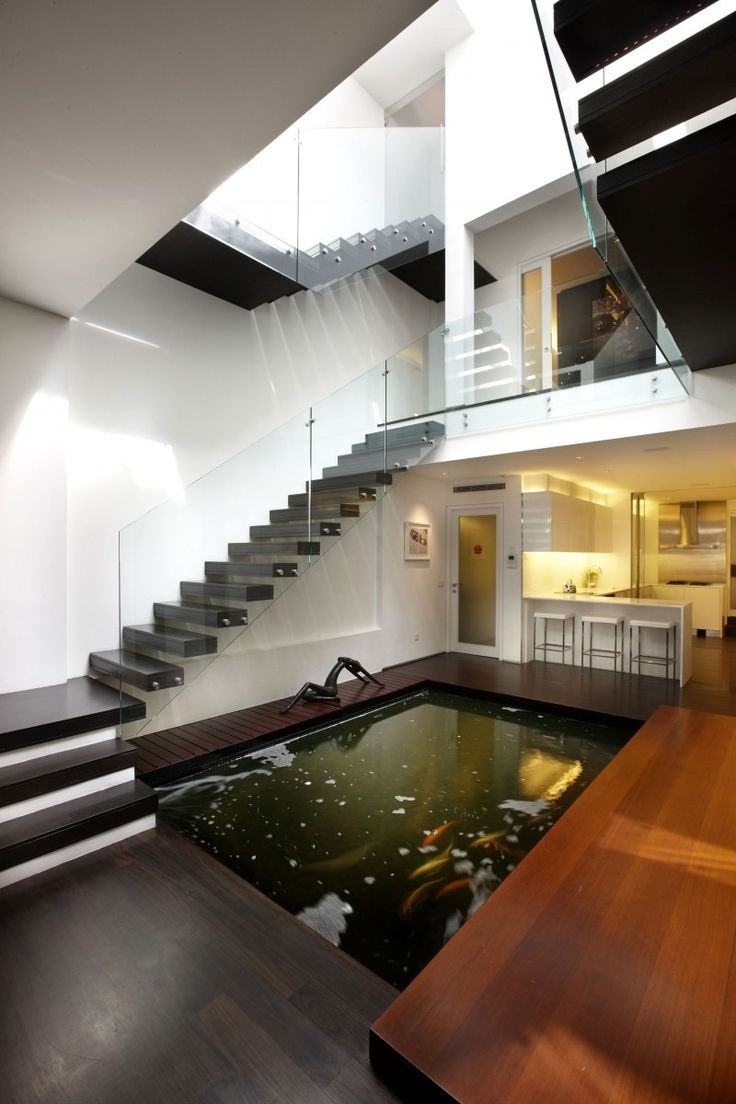 Koi fish pond inside house. Cool idea, but it seems like the maintenance for it would be increased if it was indoors.