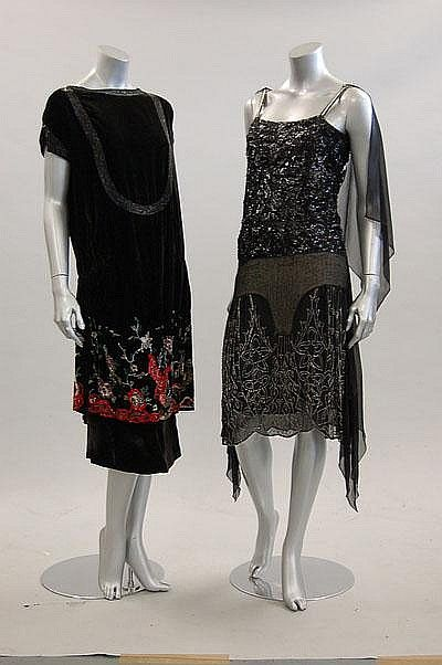 ~Beaded black flapper dresses, circa 1925-1928, one of  velvet with red and pearlized beads with parrots in flight and peonies to skirt; the other of chiffon and tulle with silver beading~      via Kerry Taylor Auctions.