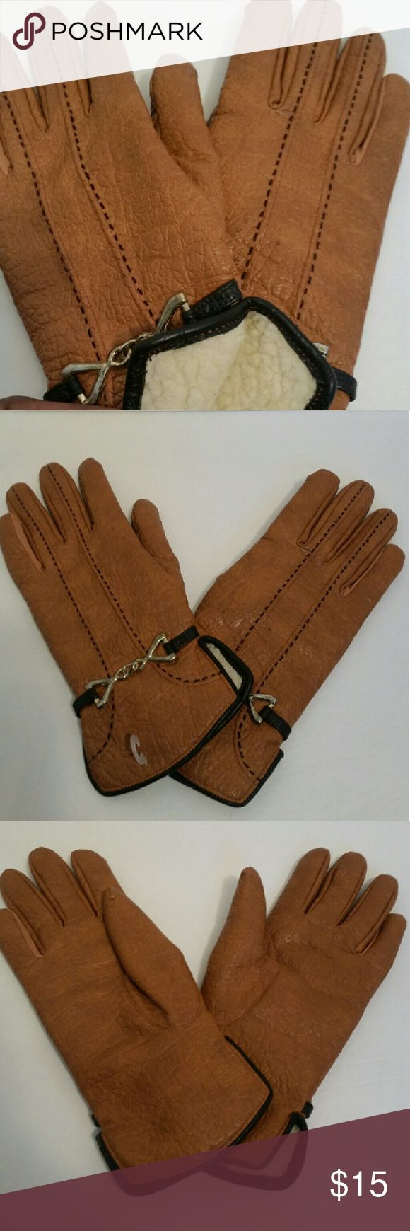 Nwot vintage Aris camel gloves w/black trim L Nwot vintage camel gloves w /black trim and fleece lining   Large  Good condition hardware is slightly discolored.. see pics  Material content tag states as follows: Vinyl with cotton backing Lining 60% acrylic 40%dacron Polyester w/100%backing  ❣pictures are part of the description  ❣No trades or off site transactions/communications ❣Open to reasonable offers ❣same day shipping Mon-Sat if purchased before 2:30pm central time  ❣4.9 rating…