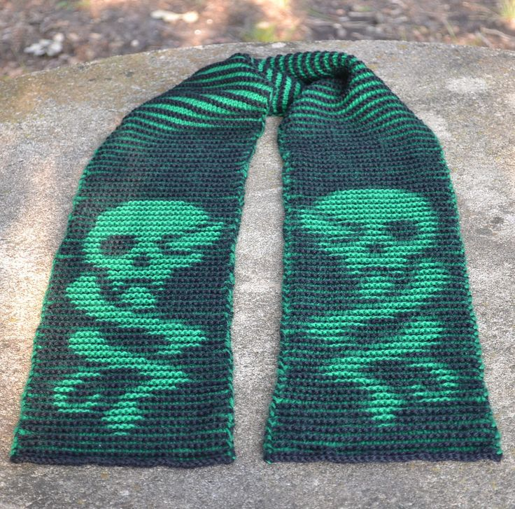 Free Knitting Pattern for Harry Potter Dark Mark Scarf - Skull motif inspired by Harry Potter series and designed by Lindsay Henricks is only visible from certain angles. Pictured project by Golubka