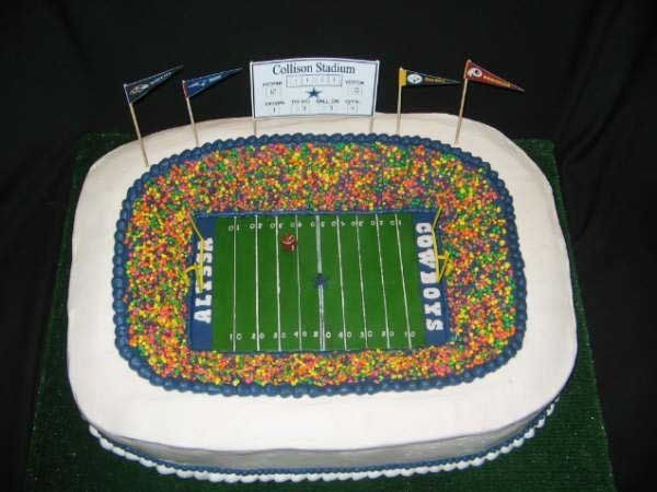 Here is my version of the football stadium cake. It was for a girl's 12th bday football party! The kids loved it! It was a pretty massive cake. I used 3 - 12X18 cakes that I carved and stacked together. Buttercream icing. The field is Fondant over cardboard so I could work on the details and then just lay it in the stadium w/o messing it up! The 'Fans' are Nerds candy. They loved it! The scoreboard is just made from my computer.