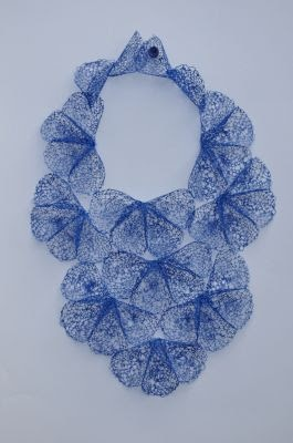 Necklace | Laura Anne Marsden.  This textile designer has developed a technique of making lace from old plastic bags.