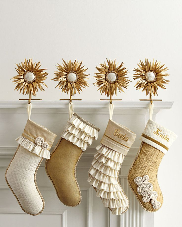 white and gold Christmas Stockings. We should hang these on the table or bread rack