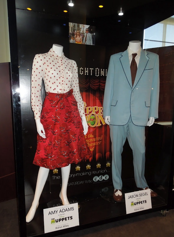 Amy Adams and Jason Segel costumes and props from The Muppets movie on display...
