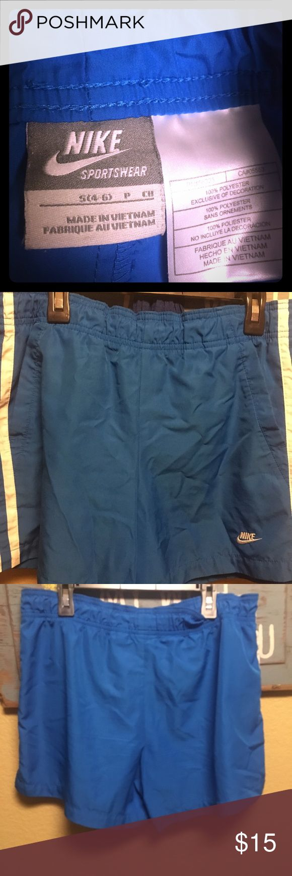 Nike Royal Blue shorts Royal blue nike shorts. Size states Small , fits more like a large. Side pockets & working drawstring. Great used condition Nike Shorts