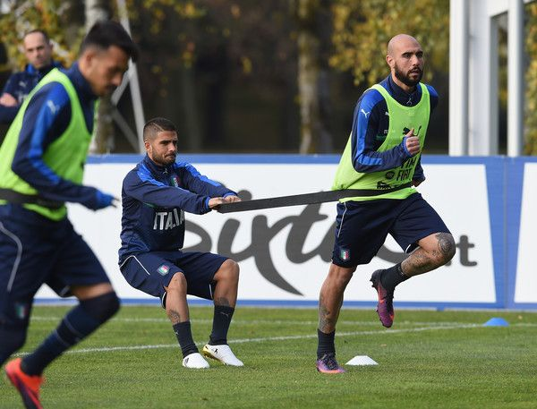 Lorenzo Insigne (L) and Simone Zaza of Italy in action during a training session at Milanello on November 13, 2016 in Cairate, Italy.
