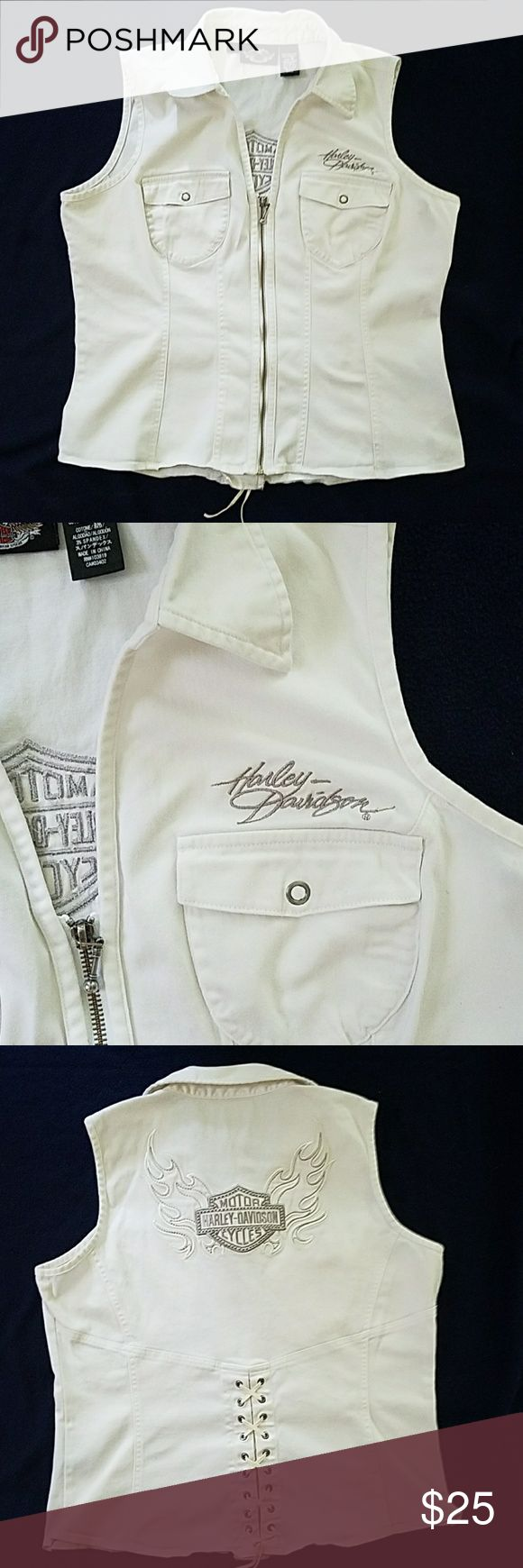 White Harley Davidson vest shirt White,Harley Davidson vest summer shirt.  Sleeveless, very detailed Harley emblem on the back with a lace detail criss cross 9 inches up the back.  Zipper front with 2 pockets.  Very comfortable shirt.  Gently used. Size large. Harley-Davidson Other