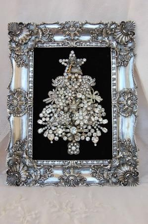Framed Christmas tree of vintage brooches. by Kim Paige